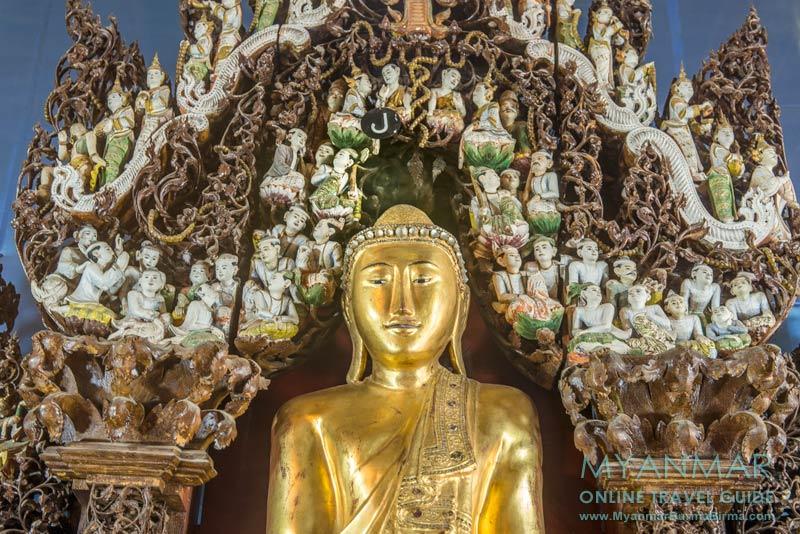 Myanmar Reisetipps | Pakokku | Altar mit Holzschnitzereien und Buddha-Figur in der Pagode Shwegu